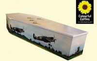colourful coffins with pictures on outside