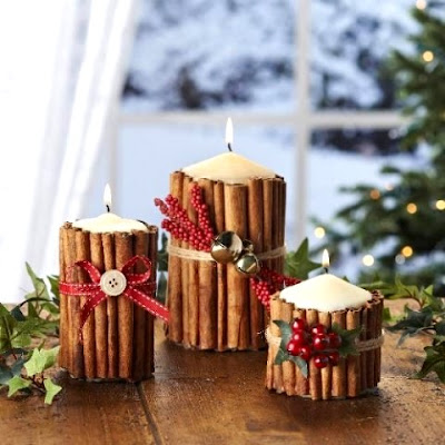 candles wrapped in cinnamon sticks and ribbon