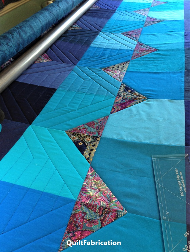 Summer Ocean quilting across the rows is in progress