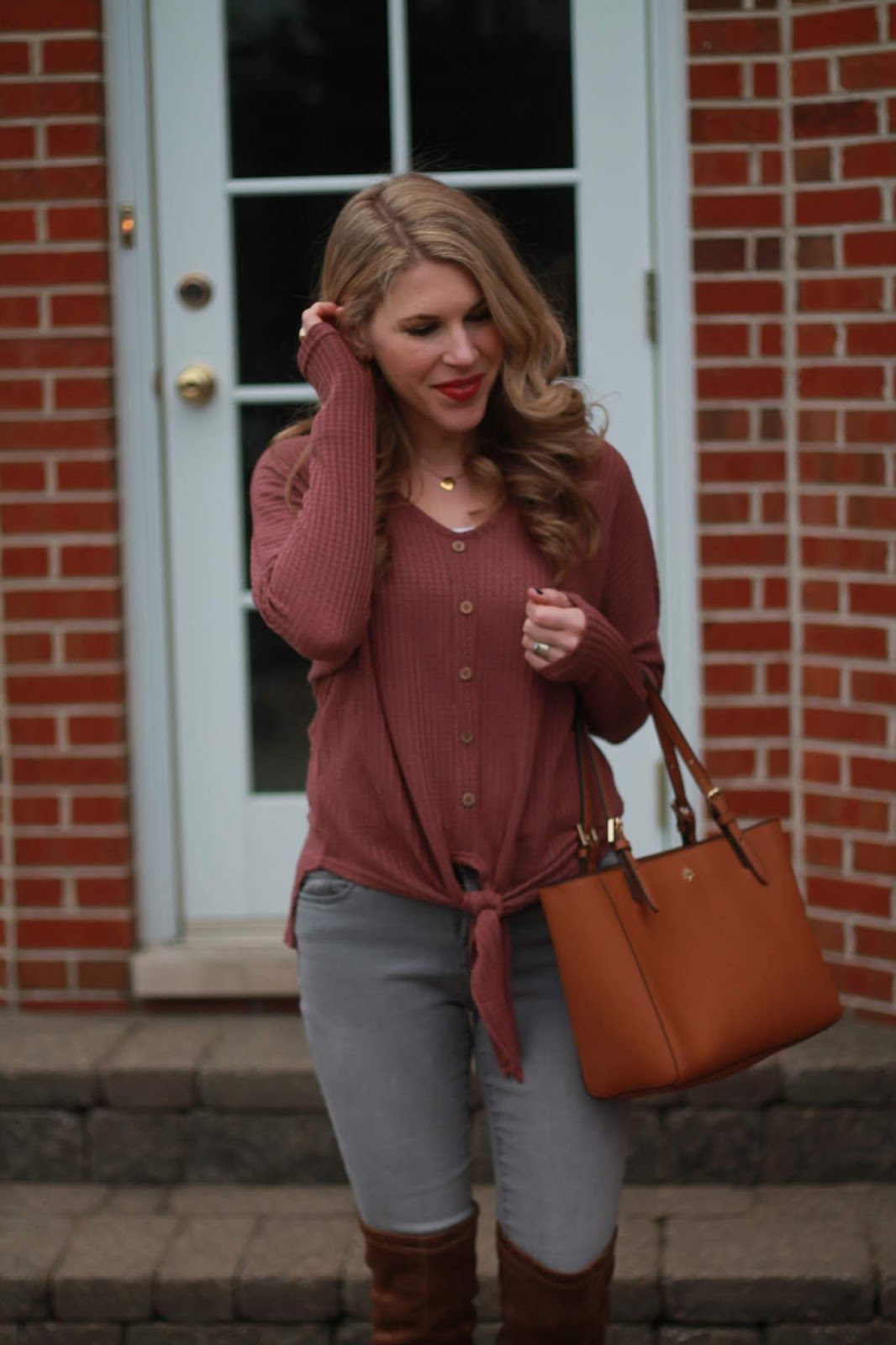 mauve tie front henley, grey jeans, brown OTK boots, Tory Burch cognac leather tote
