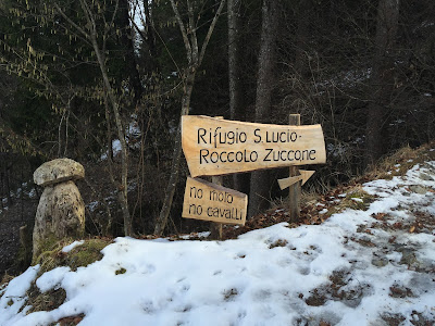"Signs to the Rifugio San Lucio and an example of one of the many carved mushrooms you see on the ""Zuccone"" trail"