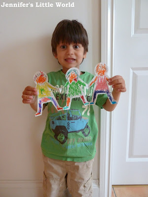 Child holding paper dolls