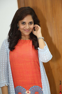 Actress Anasuya Bharadwaj in Orange Short Dress Glam Pics at Winner Movie Press Meet February 2017 (56).JPG