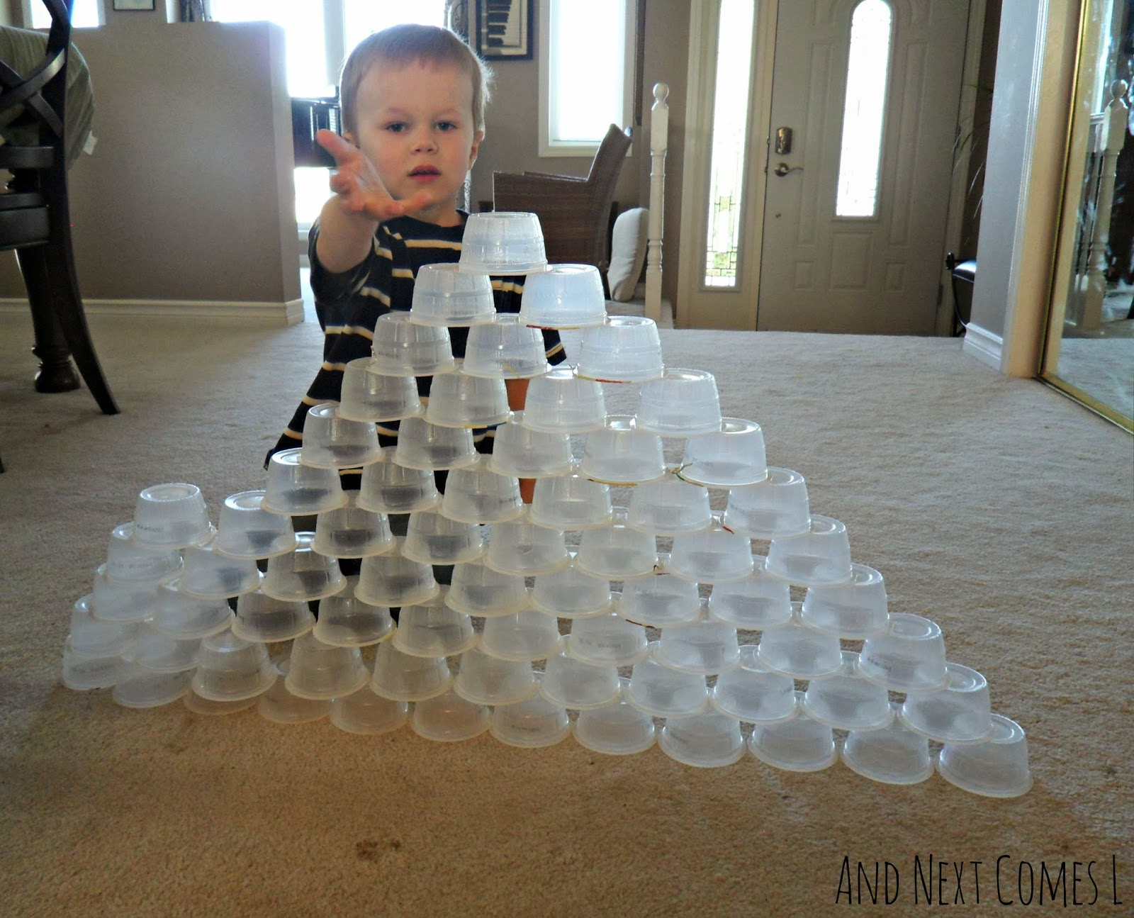 Boredom buster STEM challenge for kids: building with plastic cups from And Next Comes L