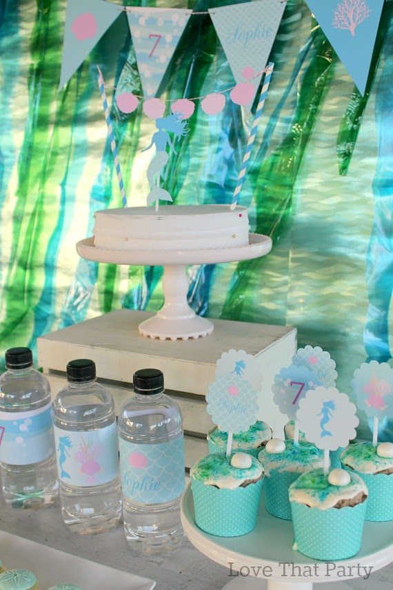 image of mermaid party dessert cake table