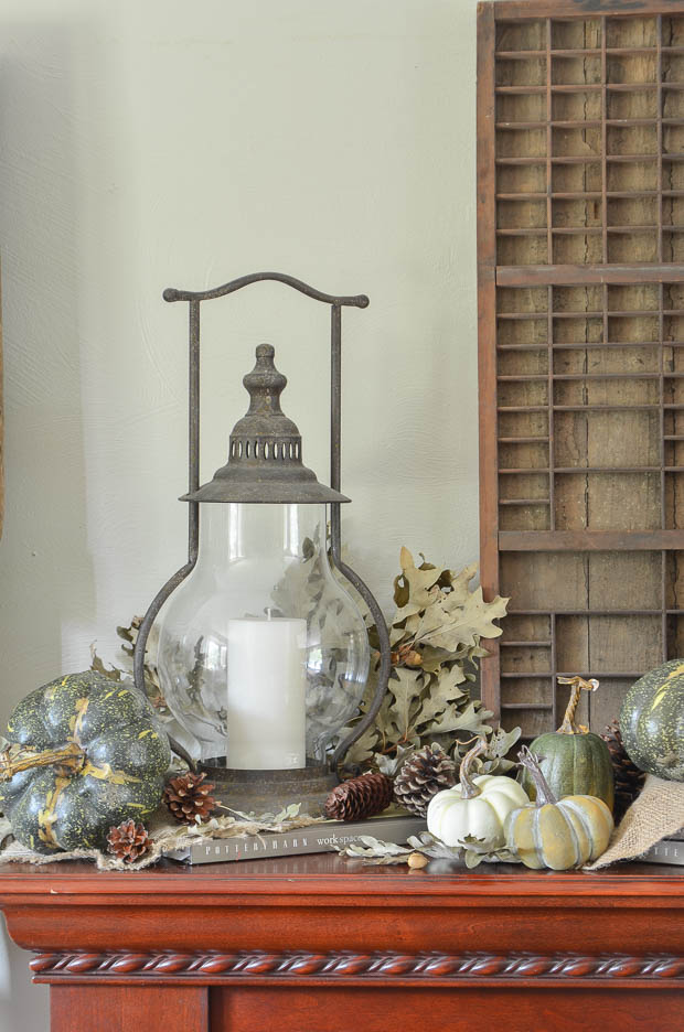 A rustic metal lantern completes this mantel for fall.