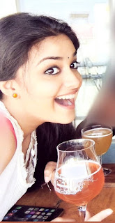 Keerthy Suresh in White Dress with Cute Smile for Drinking Green Tea