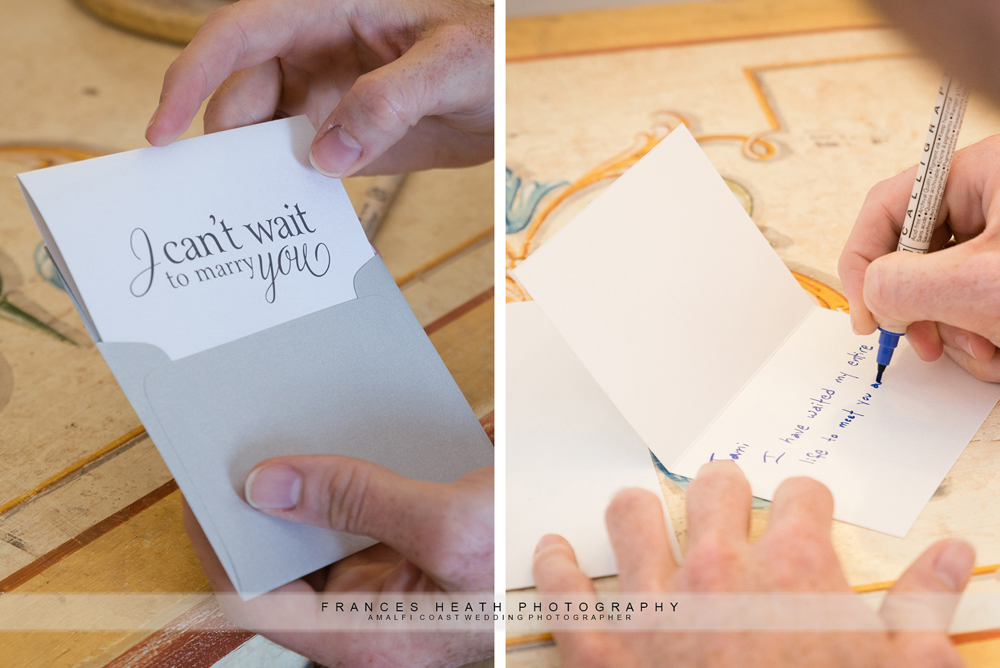 Groom writing card for bride on wedding day