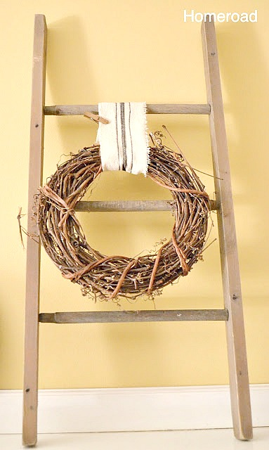 ladder with grain sack ribbon and a wreath