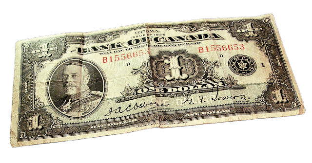 An old one dollar bill from Canada, circa 1937.