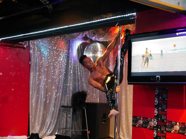 A sexy athletic work out on stage at Village, a gay bar in Doyama, Osaka, Japan.