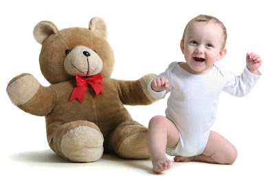 baby-playing-with-cuteTeddy-bear-White-background
