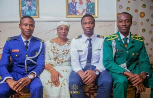 Proud Mum Poses With Her Three Uniformed Sons... Army Officer, AirForce Officer & Pilot