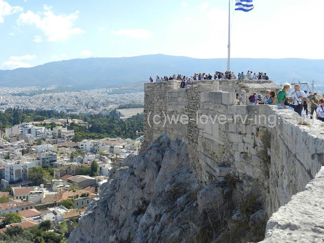 The rock and blocks support the walls of the Acropolis