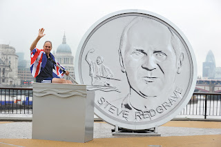 Sir Steve Redgrave next to his Olympic Winning Moment Medallion