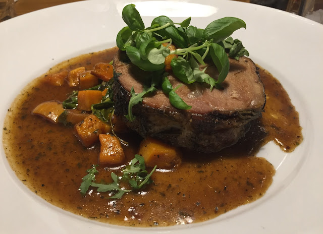 Slow-braised lamb shoulder with minted spinach, butternut squash & rosemary jus.