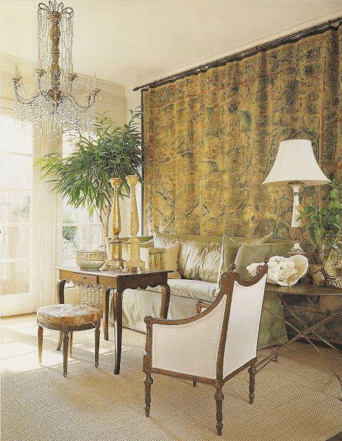 Pamela Pierce designed living room with tapestry and crystal chandelier.