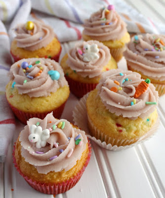 sugar cookie dough frosting swirls on cupcakes with cute bunny and carrot sprinkles