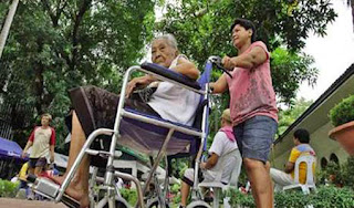 The law that guarantees health insurance for all senior citizens of the country was approved and signed by President Benigno Aquino III