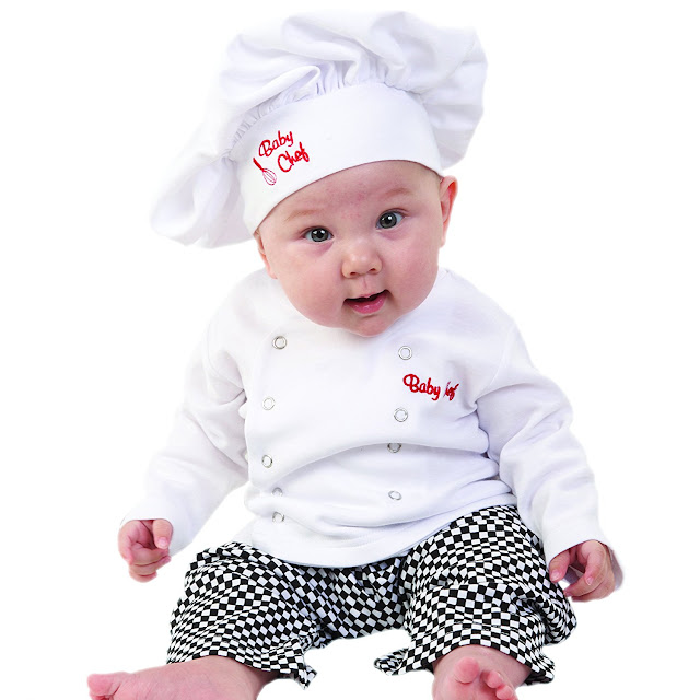 A baby in a baby chef outfit.