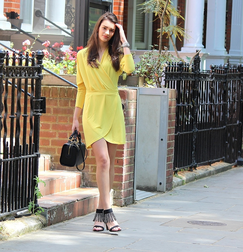 peexo-fashion-blogger-wearing-yellow-wrap-around-dress-and-black-fringe-heels-and-black-bag