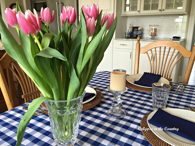 Blue and white table with pink tulips