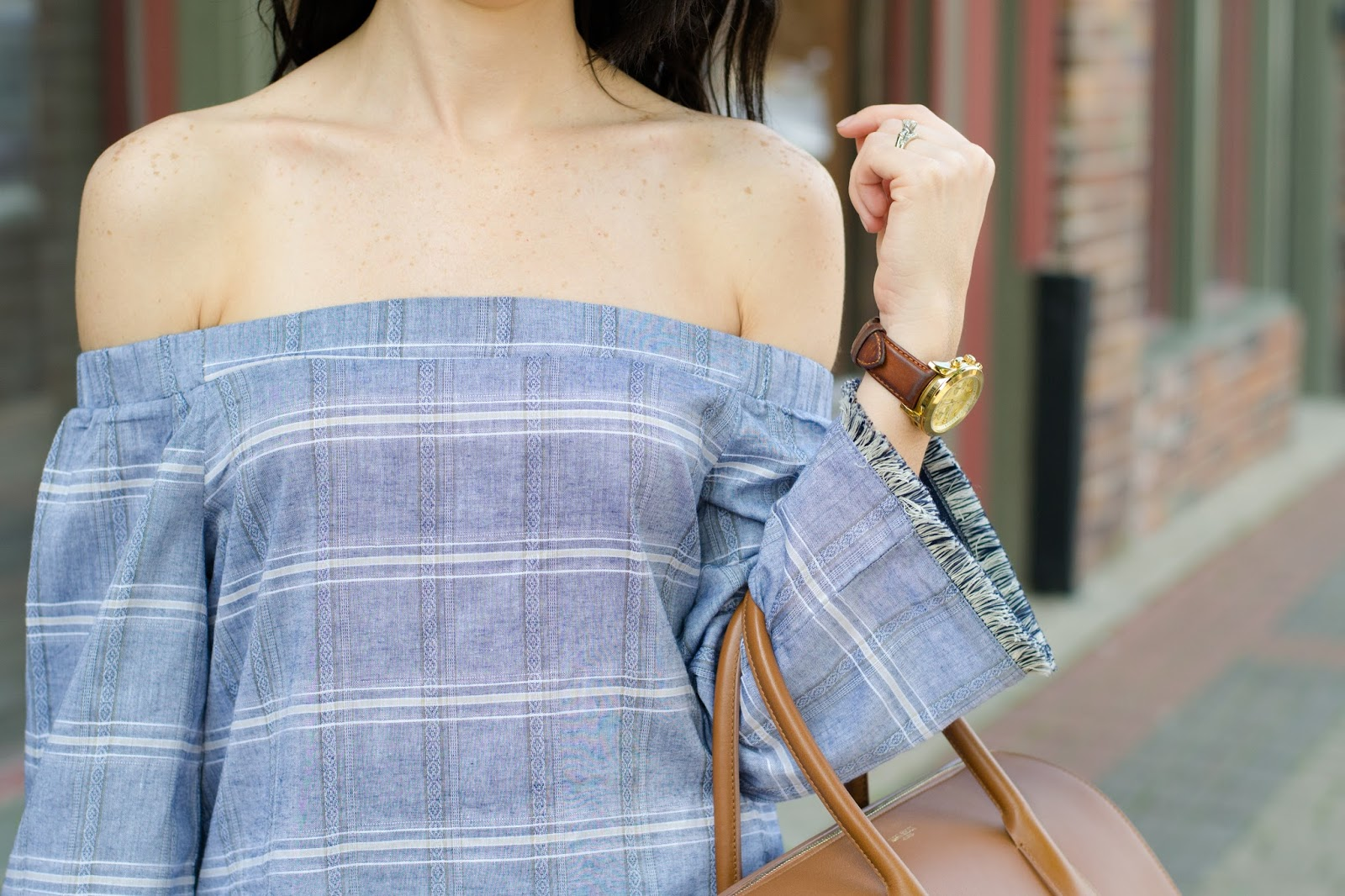 Summer off the shoulder trend, chambray and fringe paired with white jeans