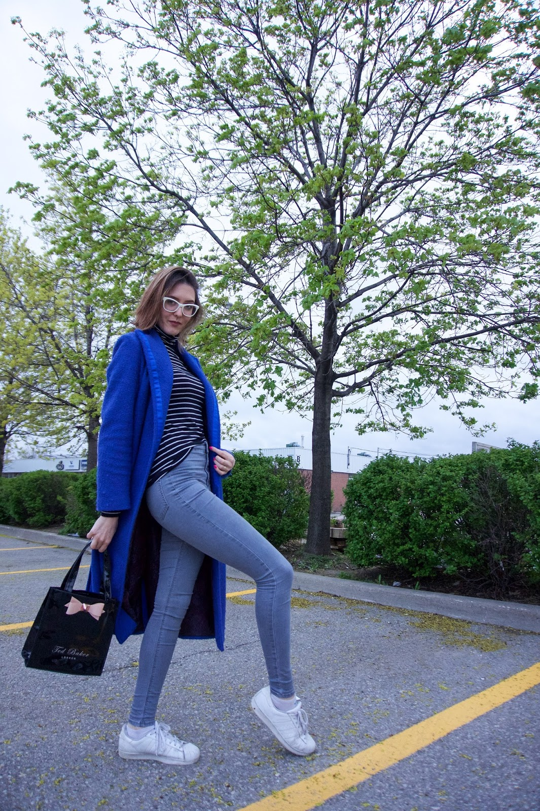 blue coat and white sneakers