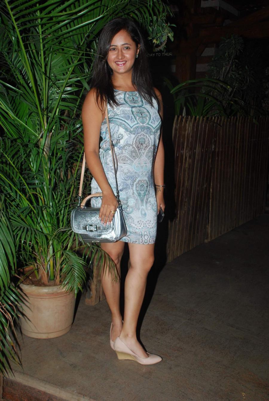 Hindi TV Actress Rashami Desai Long Legs Stills In Green Top