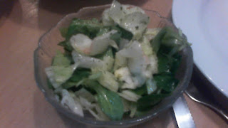 Green mixed salad in a dish