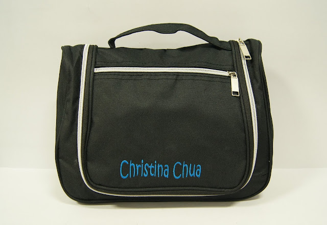 Black Toiletry Bag with blue name embroidered