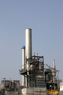 chemical processing plant exterior view from distance with stacks