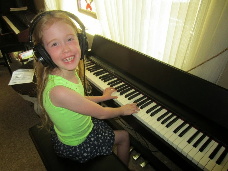 Child loves playing piano