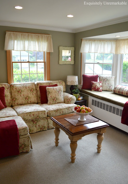 Cottage Style family room with large floral couch