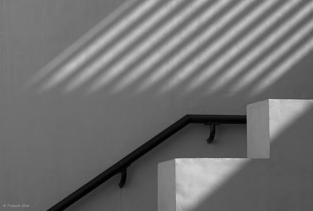 A Monochrome Minimal Art Picture of a Staircase at Jawahar Kala Kendra Jaipur with lines created both by the architecture of the stairs and the Light and Shadow Differential.