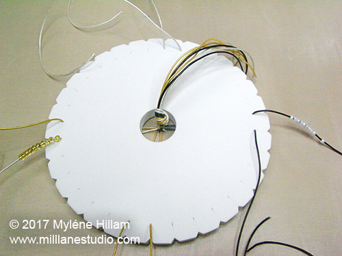 Kumihimo disk set up with cords and beads