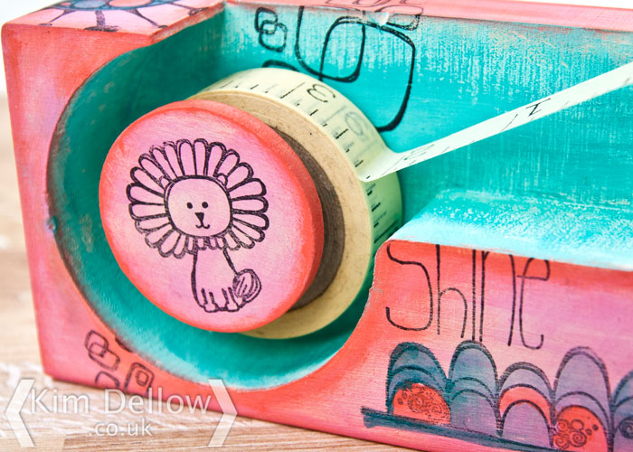 close up of Decorated wooden tape dispenser by Kim Dellow