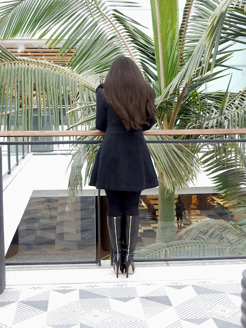 Black coat, Jimmy Choo boots, anf Frame denim jeans modeled by iammarisastewart at the Westfield Century City Shopping Center in Los Angeles Bloomingdales.