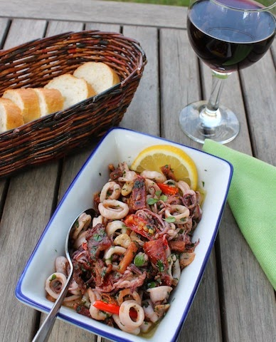 Food Lust People Love: A wonderfully fragrant tapas dish with smoked bacon pan-fried to crispy nuggets of deliciousness, along with the chilies, garlic and squid. You'll love this Squid with Garlic Chili Olive Oil.