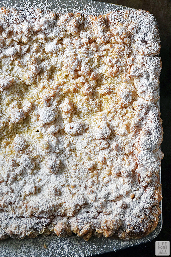Lemon Crumb Cake dusted with powdered sugar and ready to eat