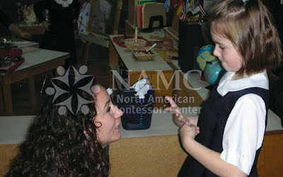 NAMC montessori parenting consequences positive discipline girl and teacher