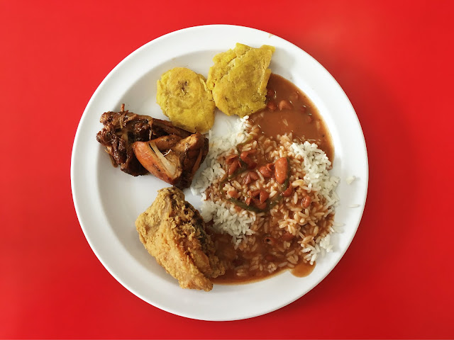 La Bandera lunch plate: Pollo Guisado, tostones, rice and beans with a little fried chicken for good measure.
