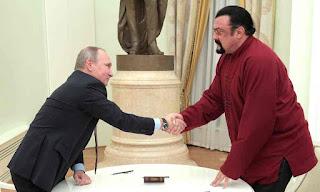 Steven Seagal receives Russian passport from Putin
