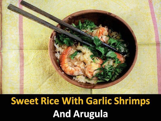 Sweet rice with garlic shrimps and arugula