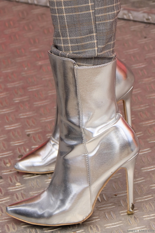 High heeled silver metallic boots in the street of amsterdam at the fashion week. street style fashion look outfit ootd candid