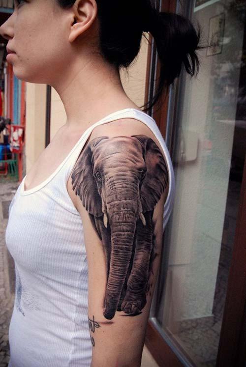 kadın üst kol fil dövmesi woman upper arm elephant tattoo 2
