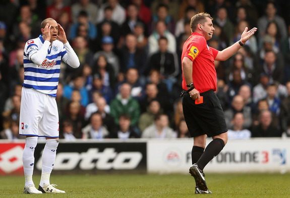 QPR player Bobby Zamora reacts after being shown a red card and sent off by referee Phil Dowd