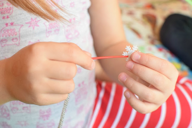 Christmas Fine Motor Button Sewing Activity. Preschoolers, kindergartners, and elementary kids will enjoying making a cheery Christmas tree while developing fine motor skills! Easy prep!