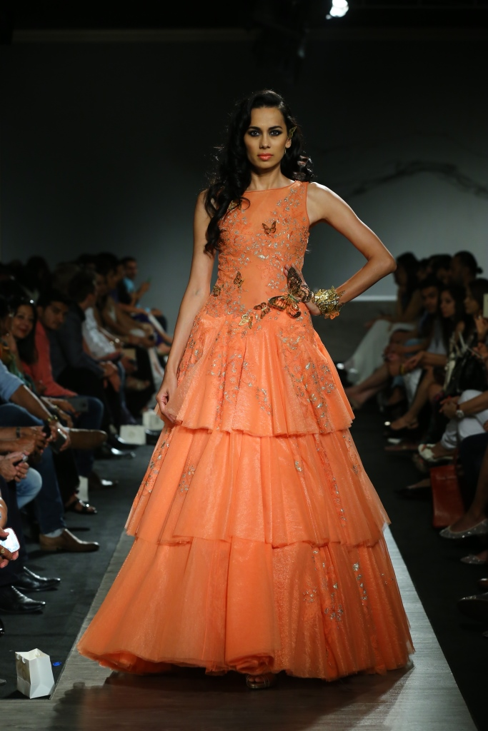 74740cd183 Kangana Ranaut walked the ramp for Manav Gangwani wearing a purple 30 kg  gown with immense detailing, hand work and embroidery. Bold eyes and nude  lips was ...
