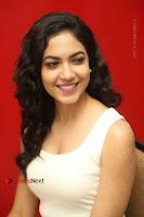 Actress Ritu Varma Stills in White Floral Short Dress at Kesava Movie Success Meet .COM 0181.JPG